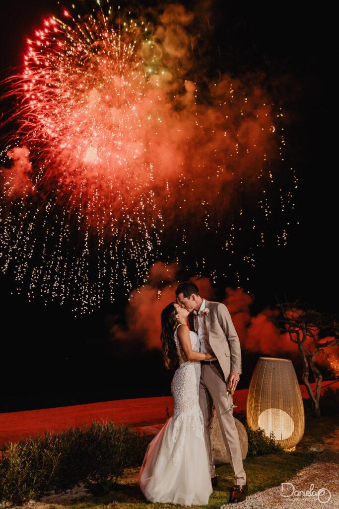 Wedding kiss with fireworks Boho wedding