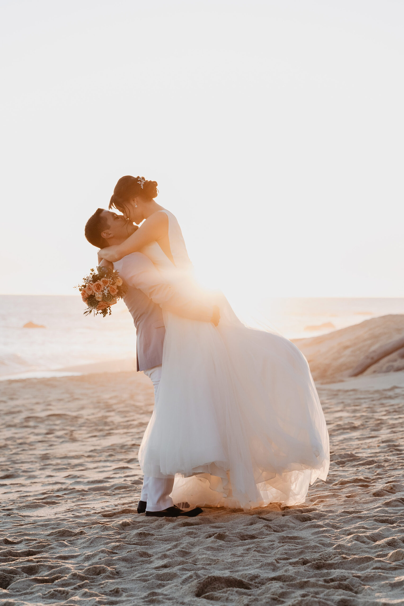 Just married couple kissing at sunset in Cabo